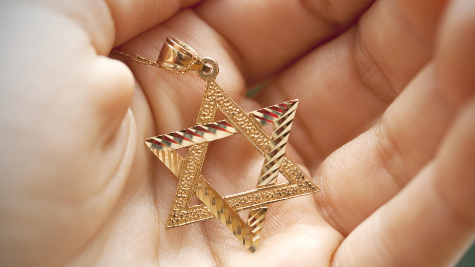 Hand holding Star of David